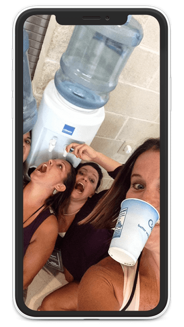 Team using the Eventzee Scavenger Hunt App completes a task to get a drink of water from a water station