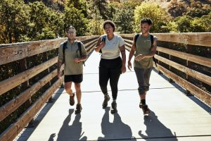 team explores outdoors during a scavenger hunt app event