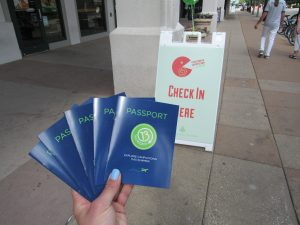 Person holding paper passports for an event in Champaign, Illinois.